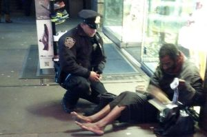 New+York+City+Police+Officer+Larry+DePrimo+presenting+a+barefoot+homeless+man+with+boots